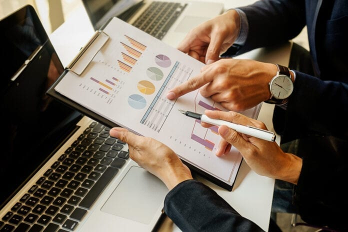 finance economics work male discussion laptop
